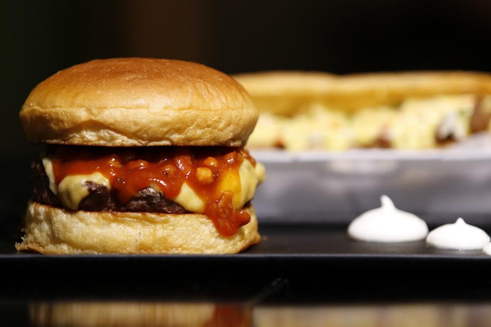 burger on black metal tray