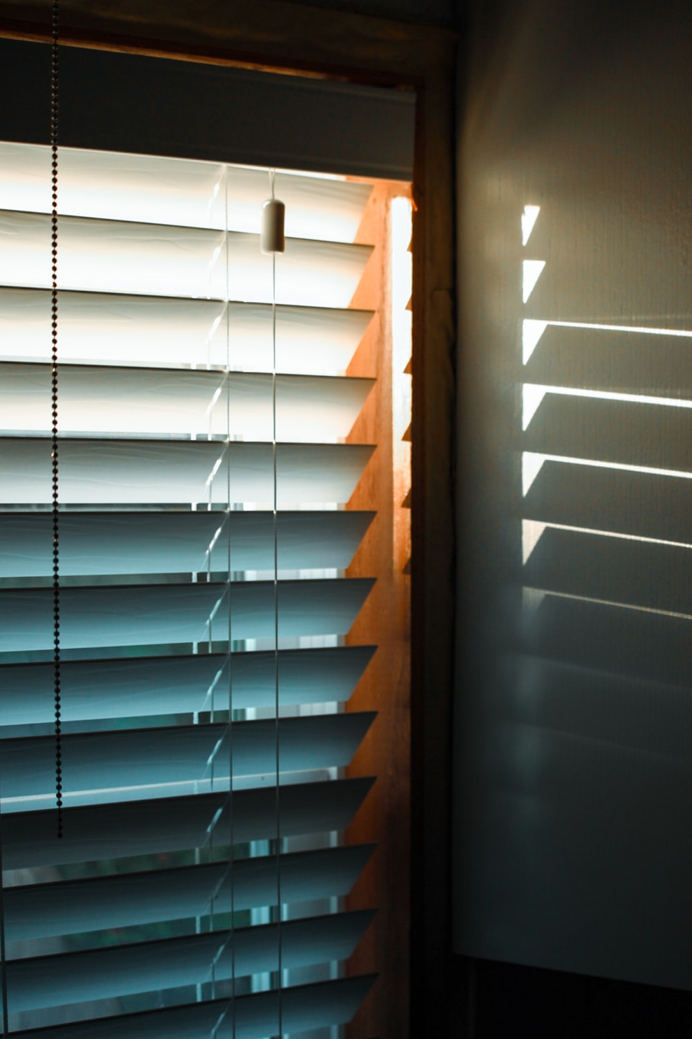 brown wooden window blinds during daytime
