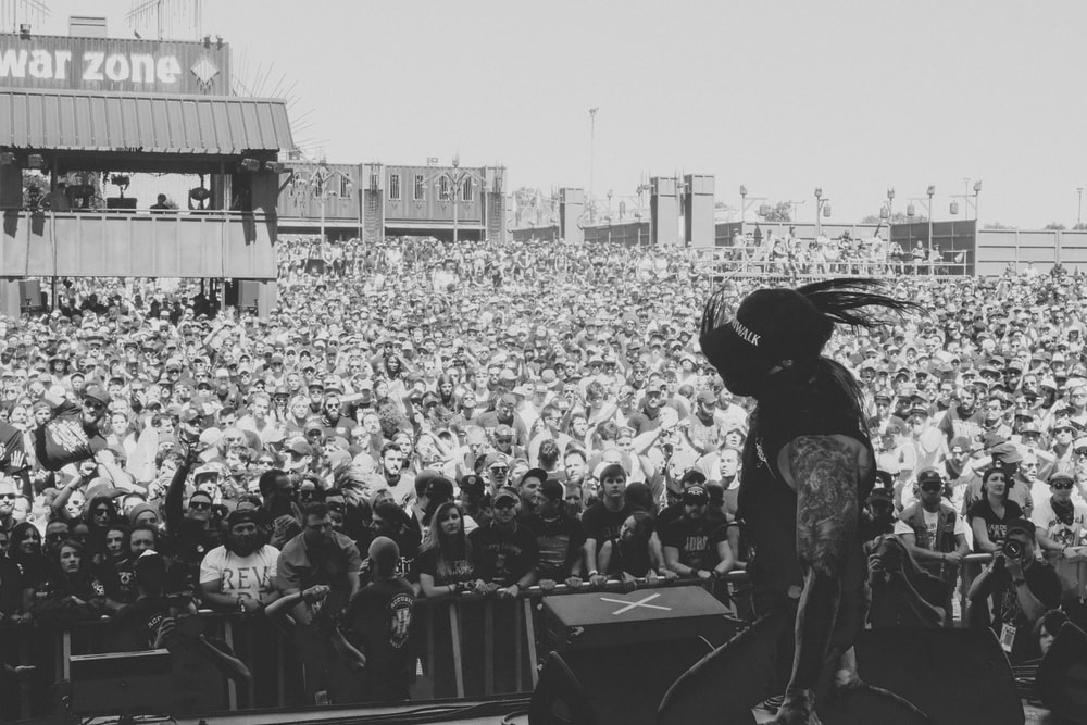 grayscale photo of people on a concert