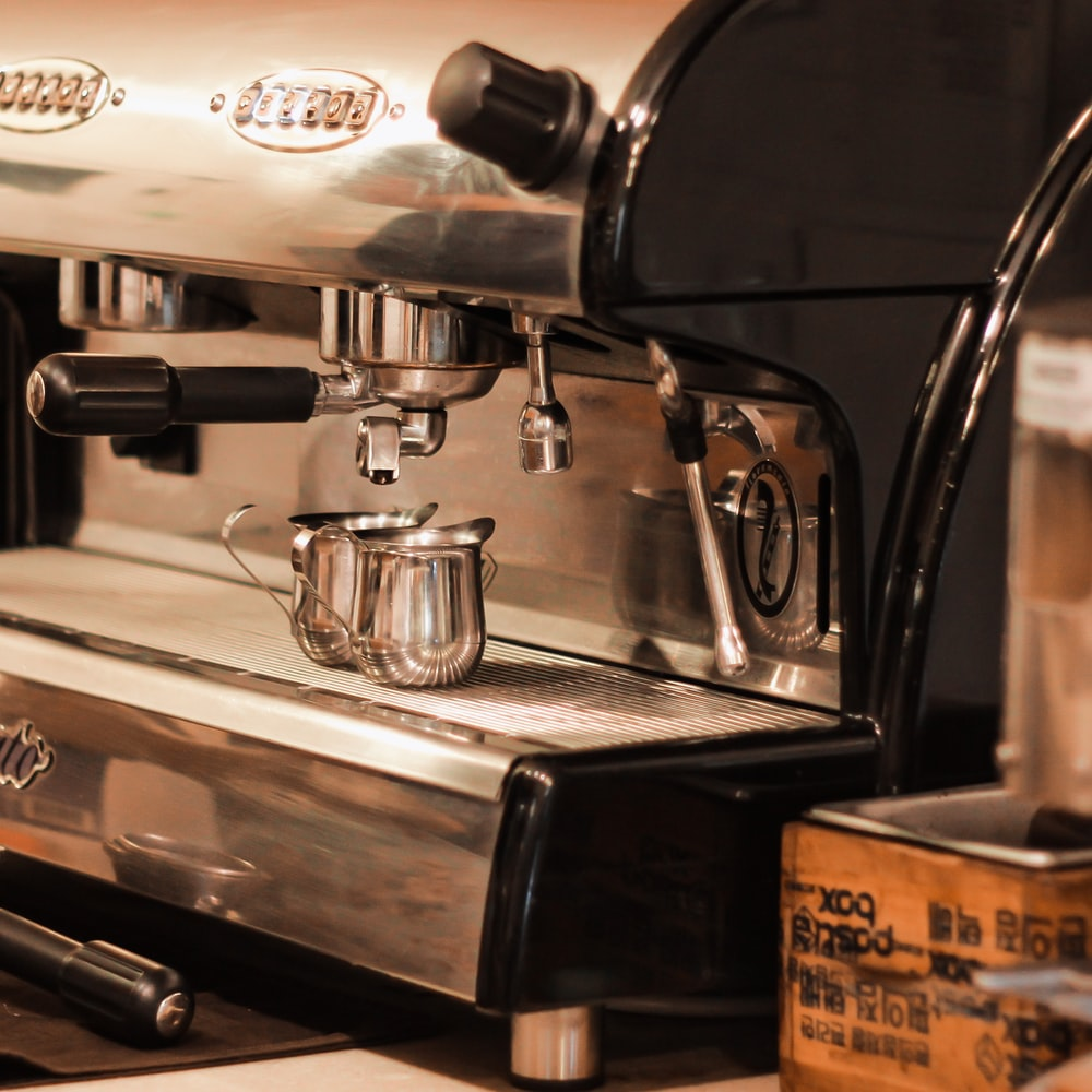 stainless steel espresso machine on table