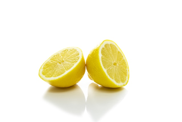 2 yellow lemon on white surface
