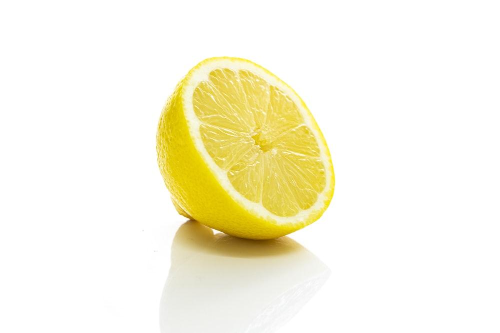 yellow lemon fruit on white surface