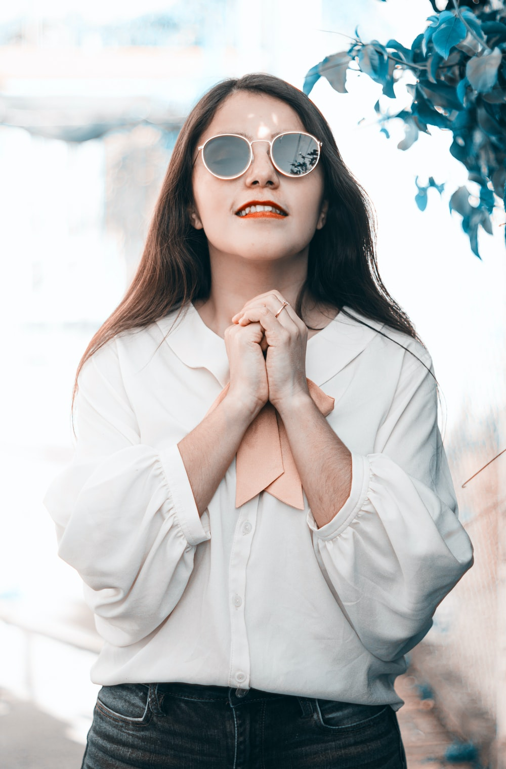 woman in white long sleeve shirt wearing sunglasses