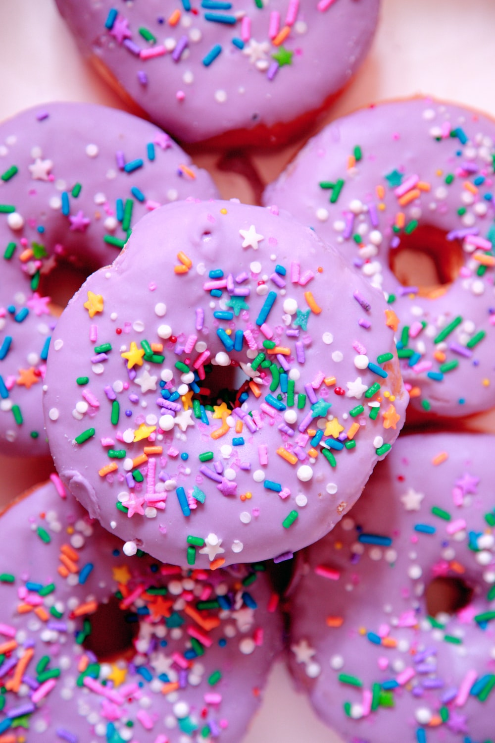 pink and white doughnut with sprinkles