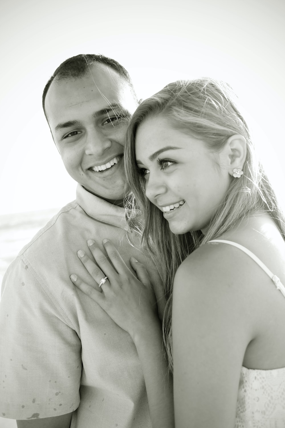 grayscale photo of woman and man smiling
