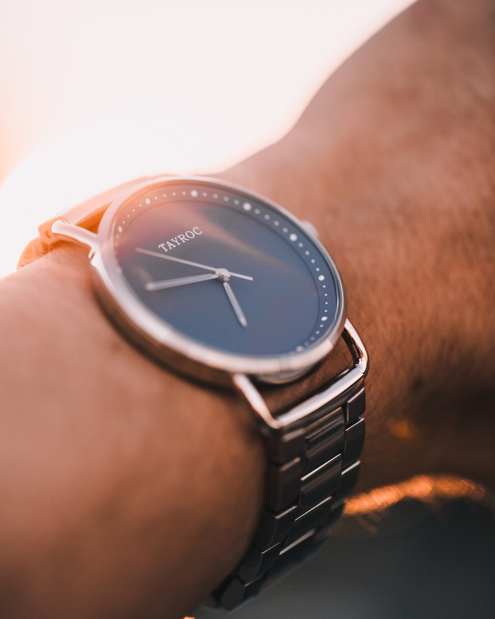 silver and gold analog watch