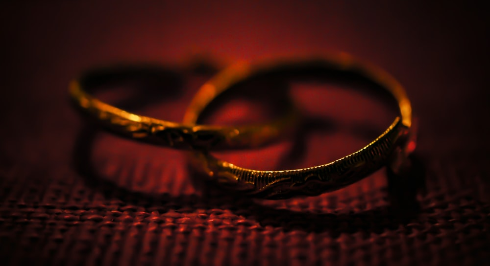 silver ring on woven surface