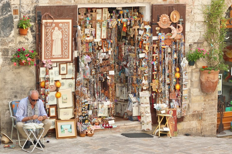 sustainable travel - souvenir store with craftsman