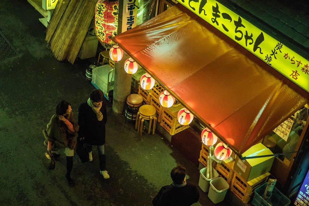 people standing near food stall during nighttime