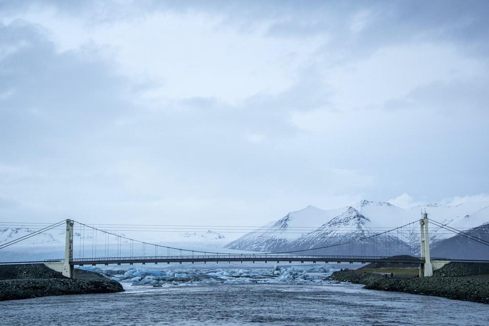 bridge over the lake under white sky