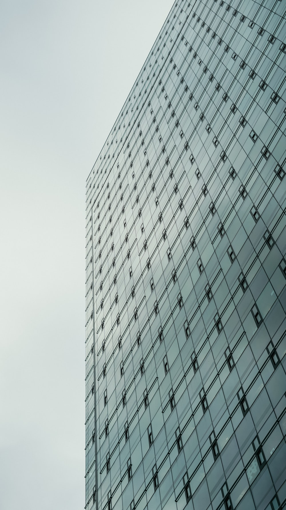 white and black glass walled high rise building