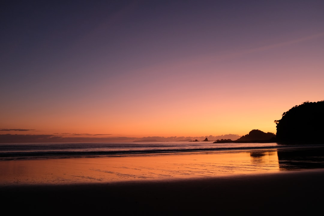 Sunrise over Motutohe Island and the Poor Knights from Moureeses Bay
