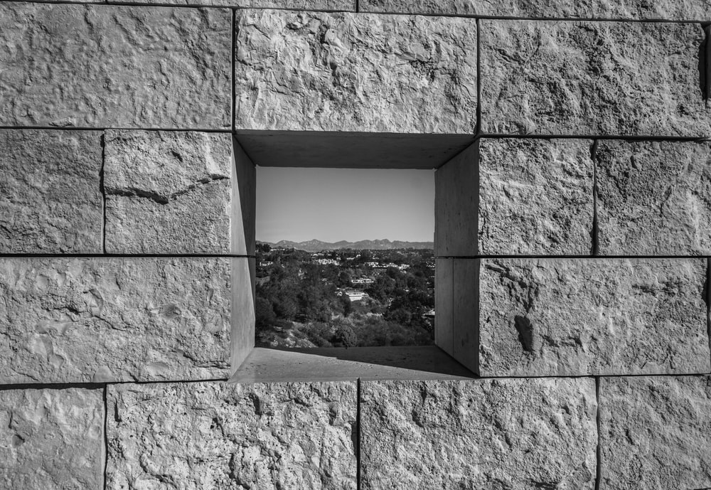 gray scale photo of concrete wall