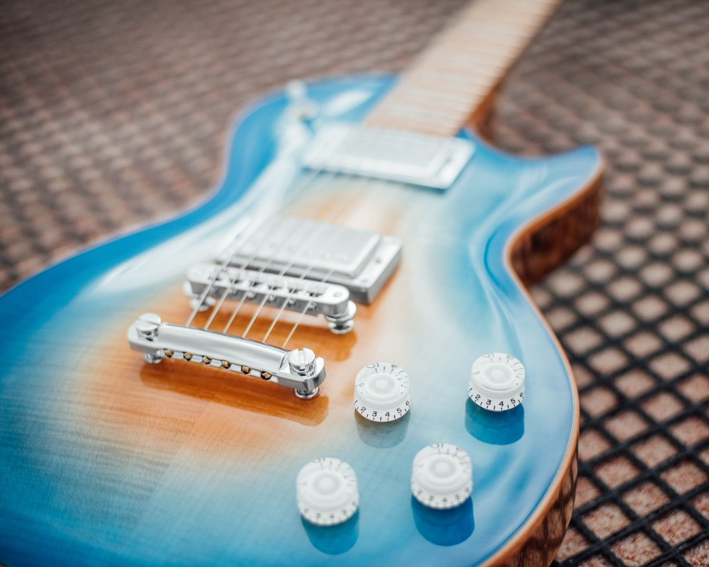 blue and white electric guitar