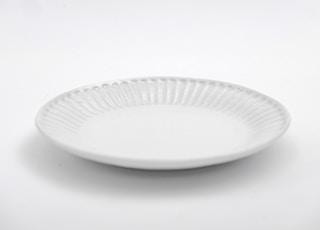 white round plate on white table