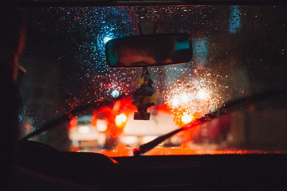 car window with water droplets