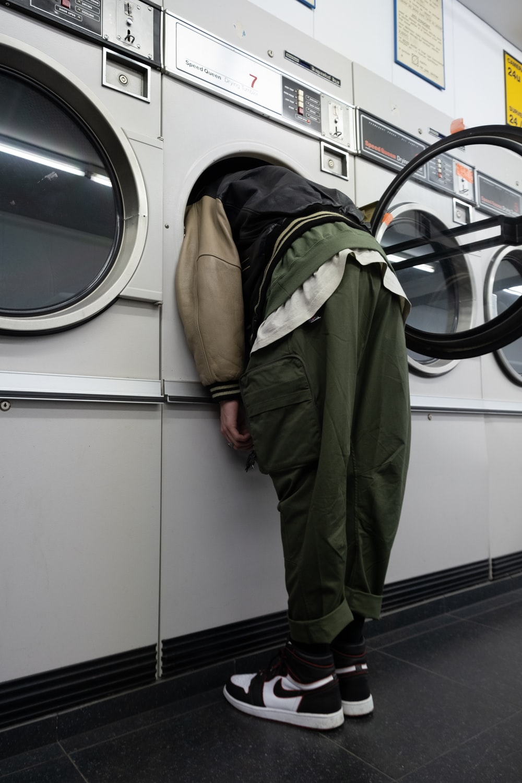 green jacket on white front load washing machine
