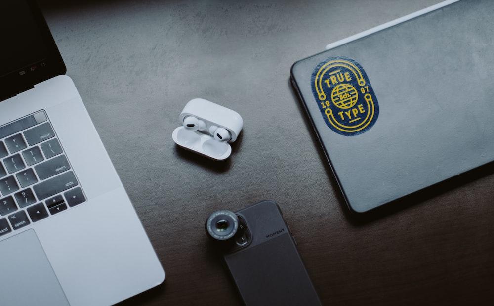 white apple earpods on gray iphone case