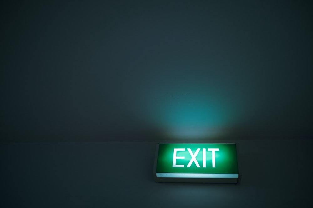 green and white exit sign