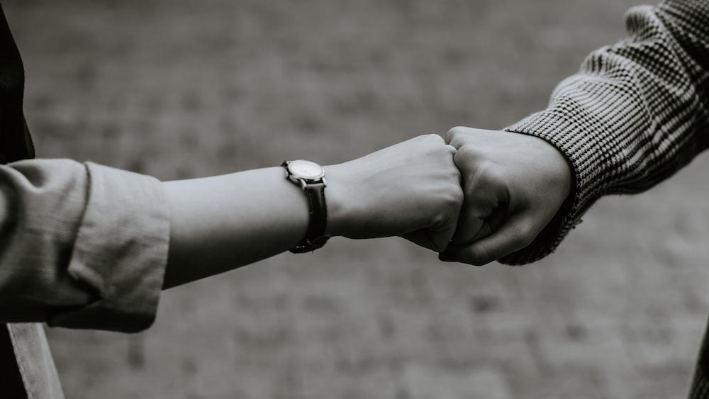 person wearing silver link bracelet watch
