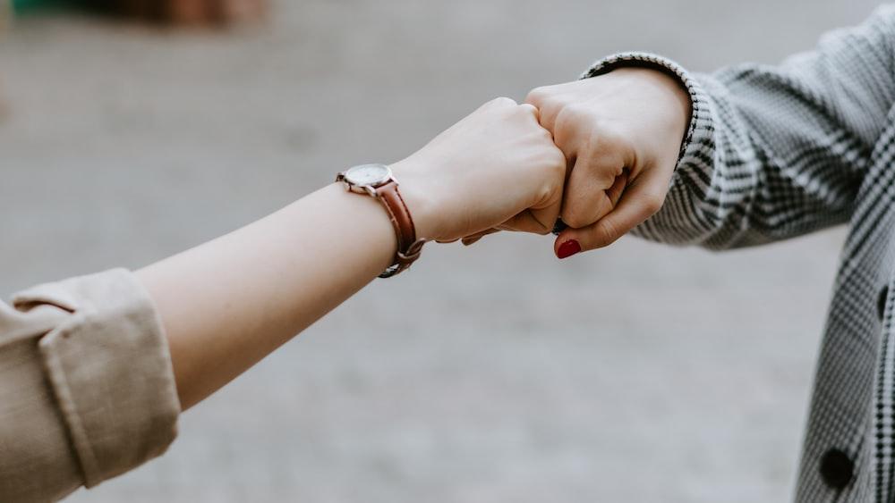 person wearing silver bracelet and bracelet