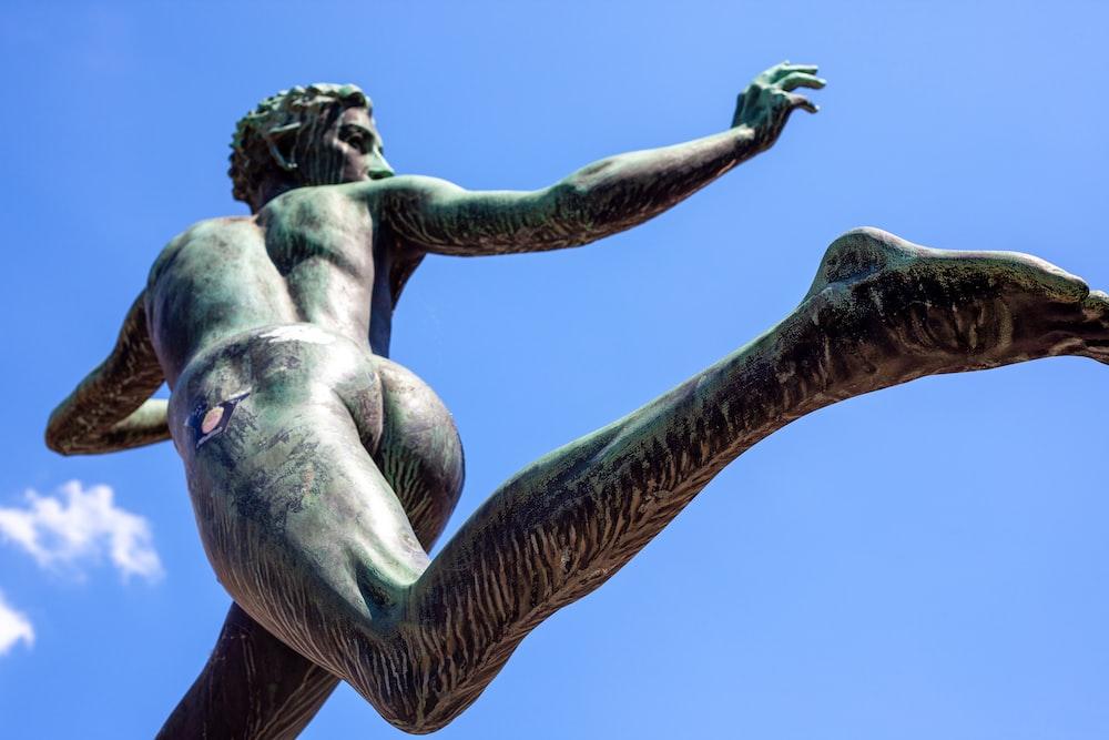 woman in blue dress statue