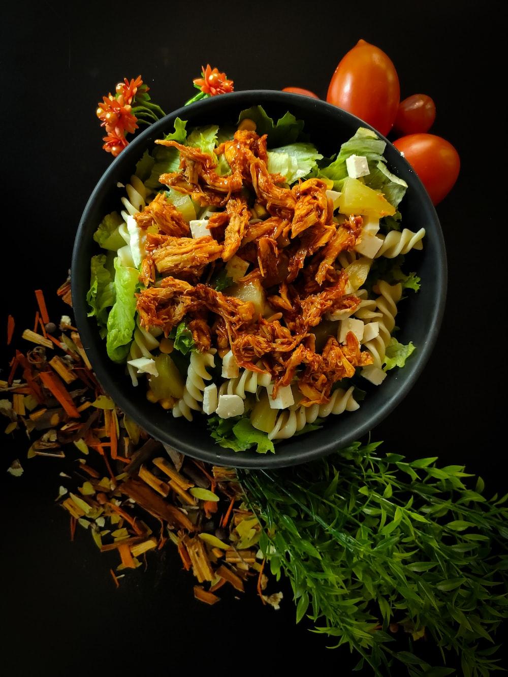vegetable salad in black ceramic bowl