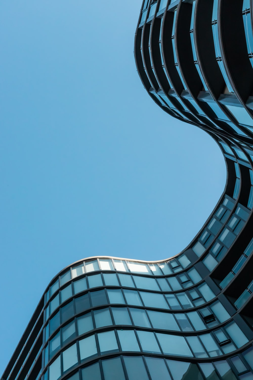 blue glass building under blue sky during daytime