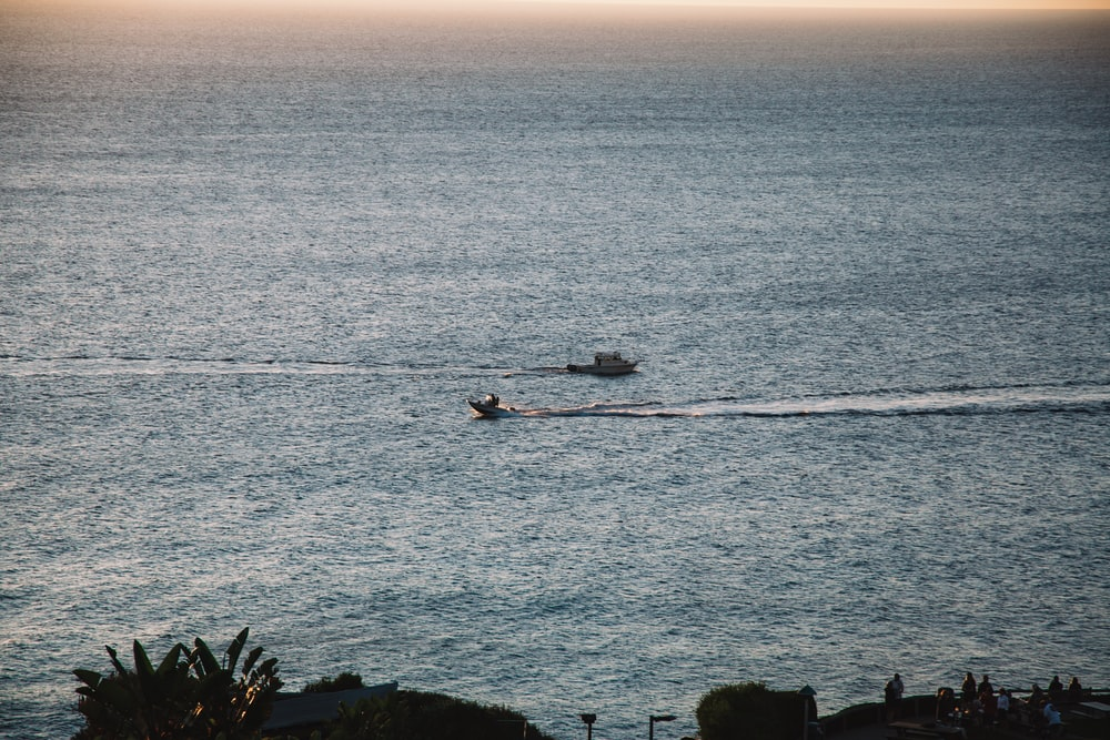 person riding on boat on sea during daytime