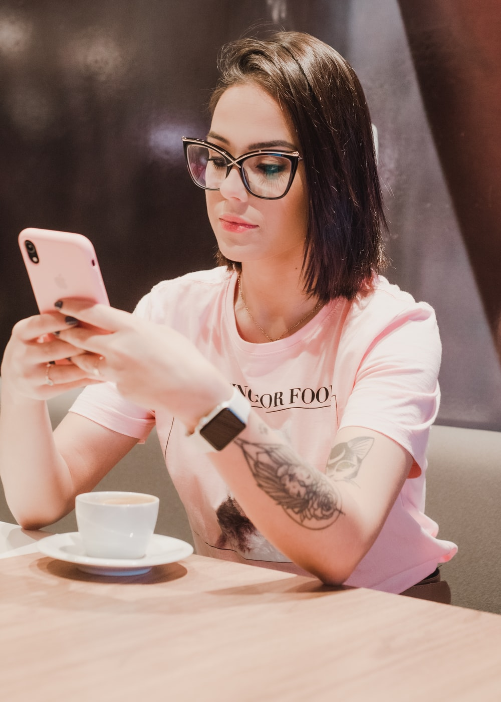 woman in white long sleeve shirt holding silver iphone 6