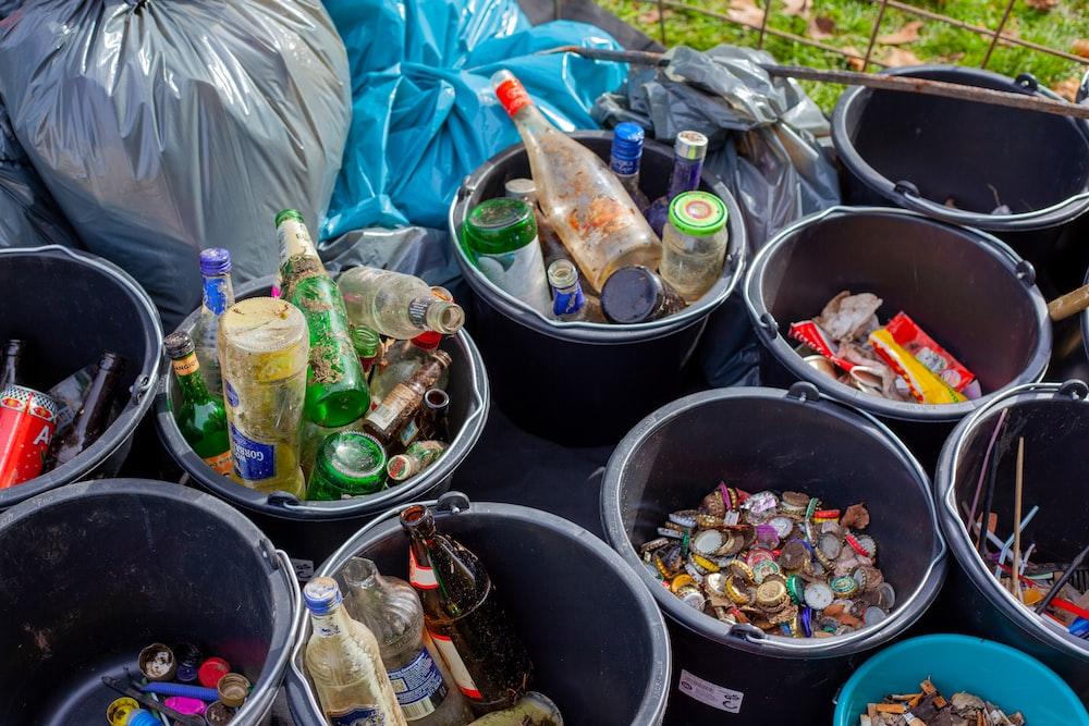 assorted plastic bottles in black plastic bucket