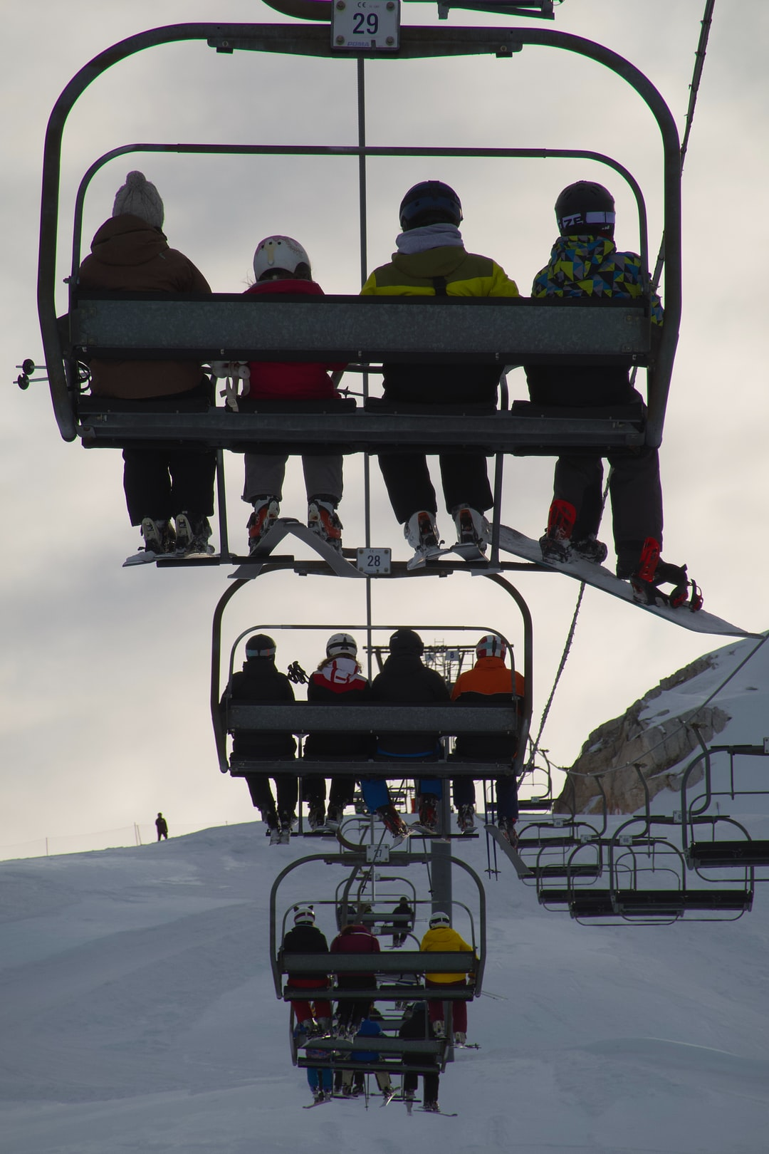 A usual view of a chairlift at peak times, everyone is on one side.