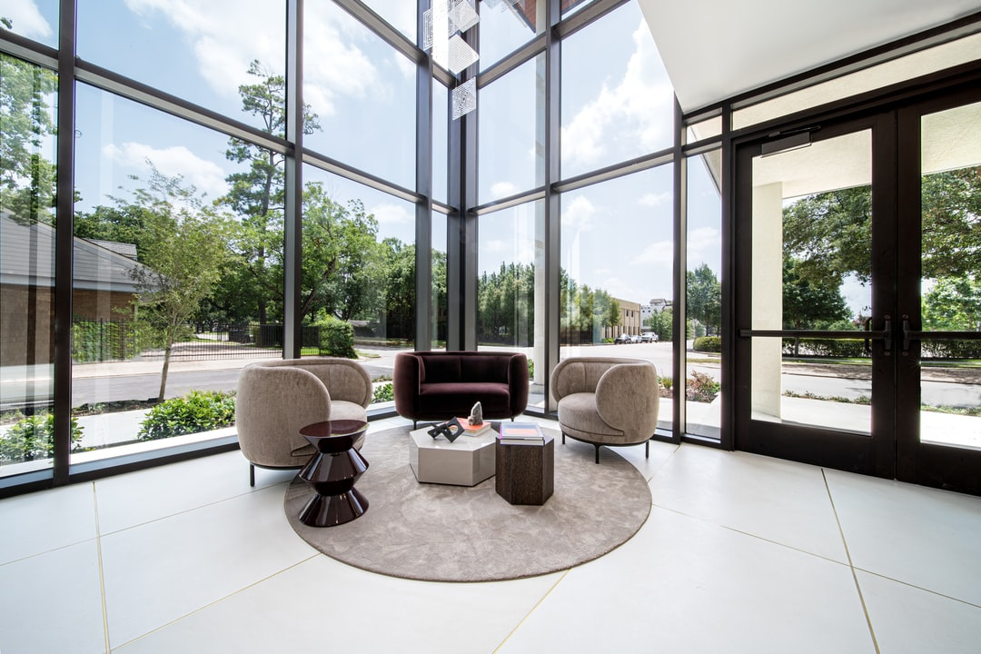 Lobby of A Condominium Building With A Large Windows and Trees In the Background. - unsplash
