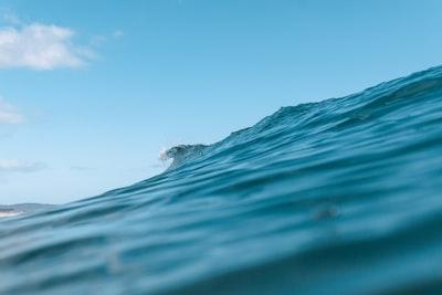 blue ocean water under blue sky during daytime seascape teams background