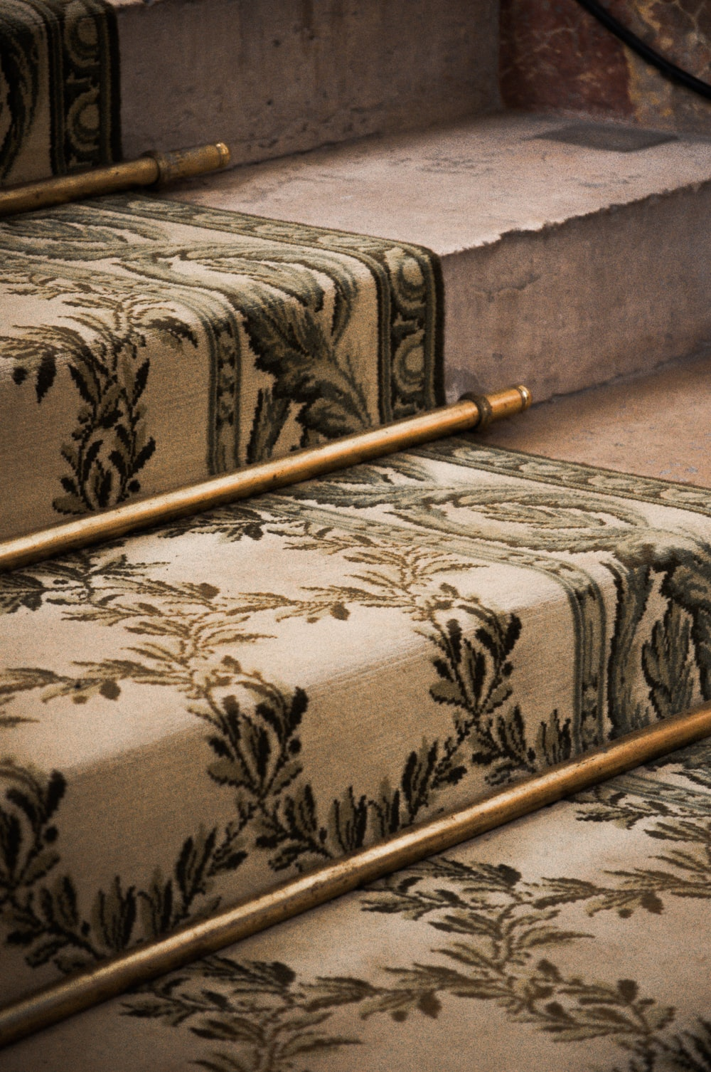 brown wooden stick on brown floral couch