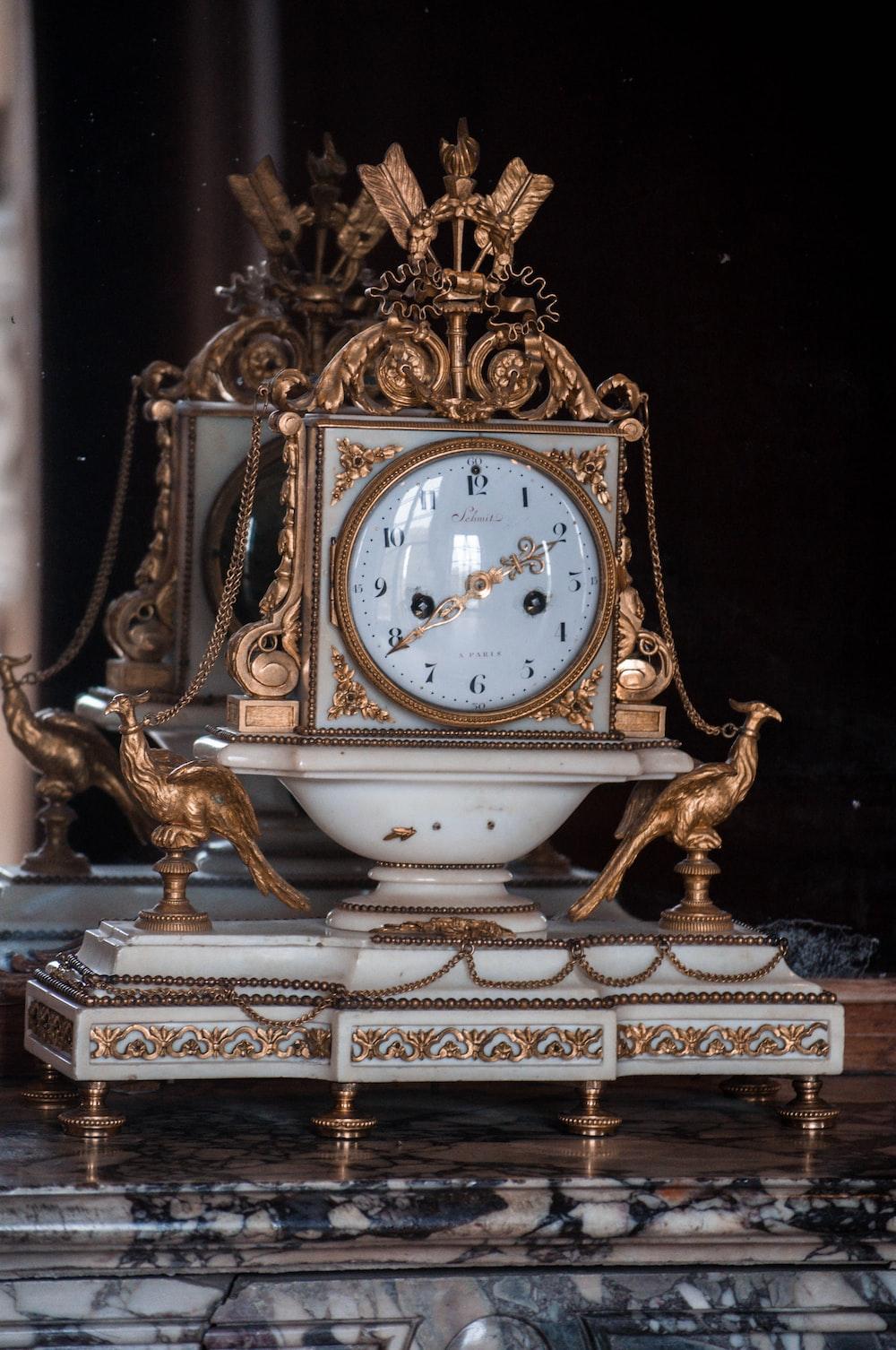 gold and white analog desk clock