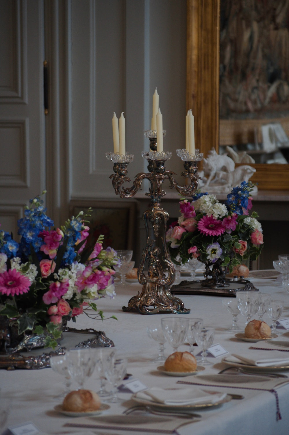 gold and white candle holder on table