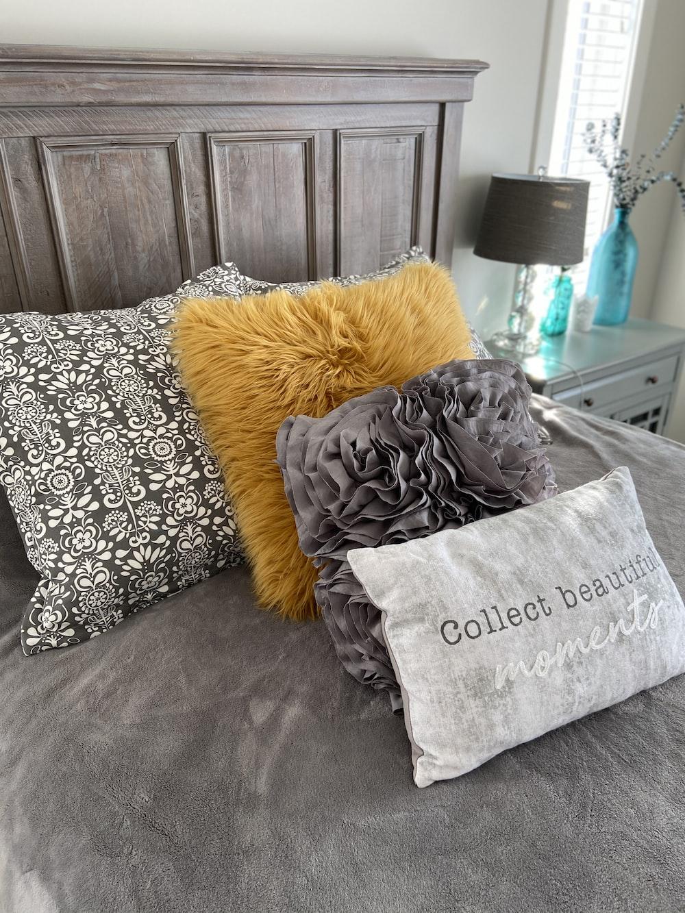gray and white throw pillows on orange throw pillow