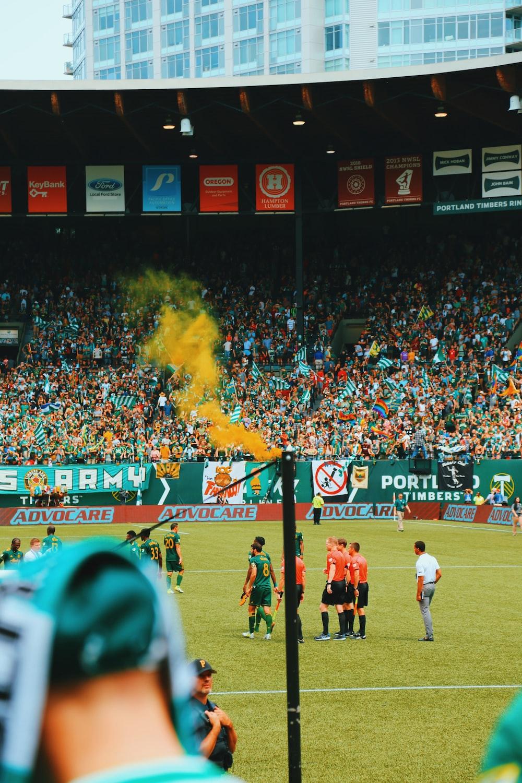 people playing soccer on stadium