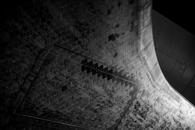 grayscale photo of brick wall space station teams background