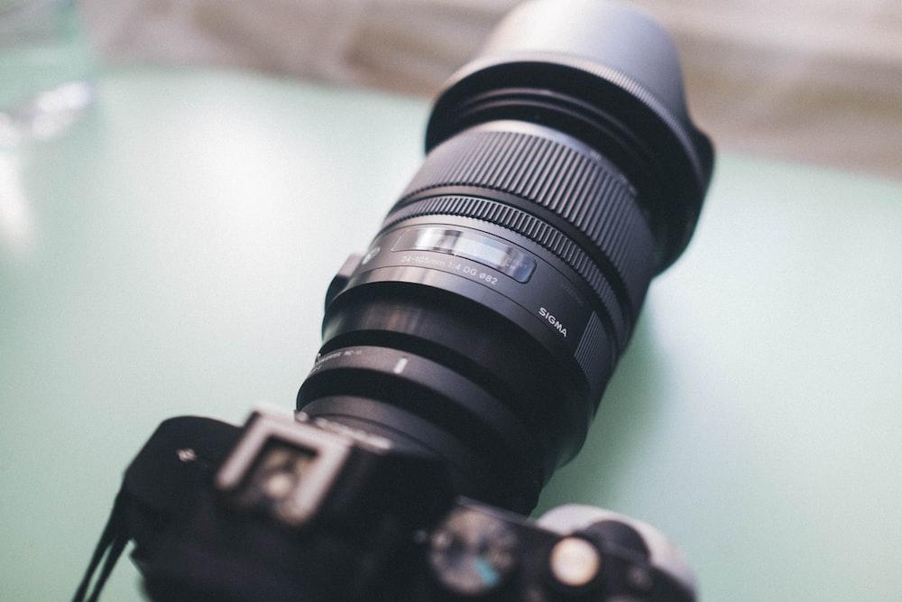 black camera lens on green surface