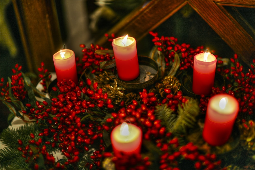 red candles on brown wooden table