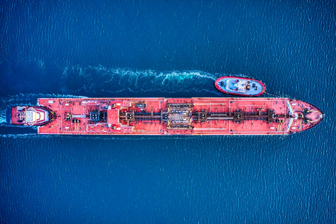 A red oil tanker shot from directly above.