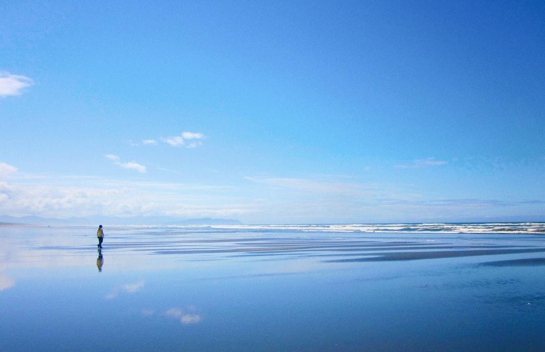 Shot of person walking on Seaside Beach, Oregon.