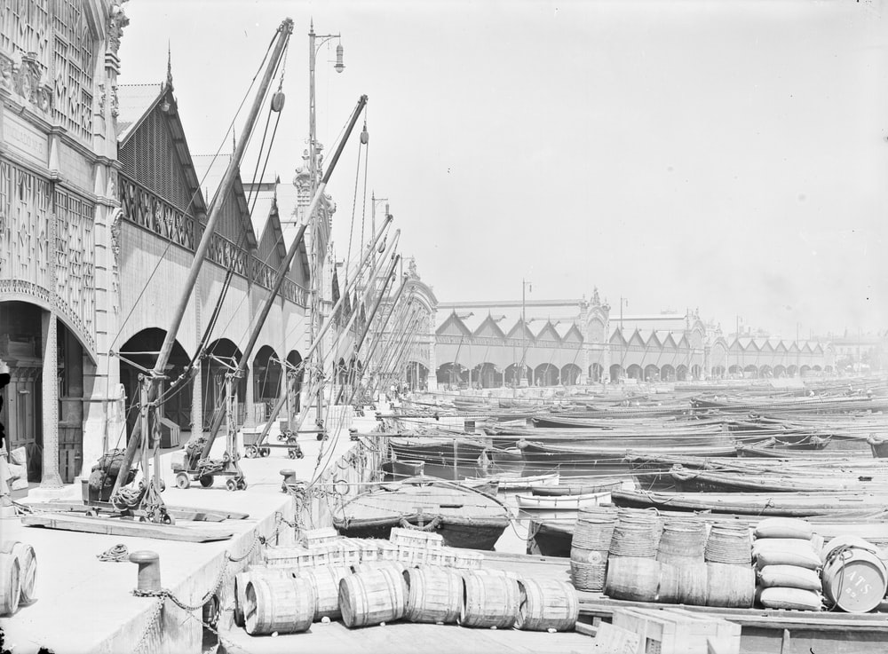 grayscale photo of sail boats on dock