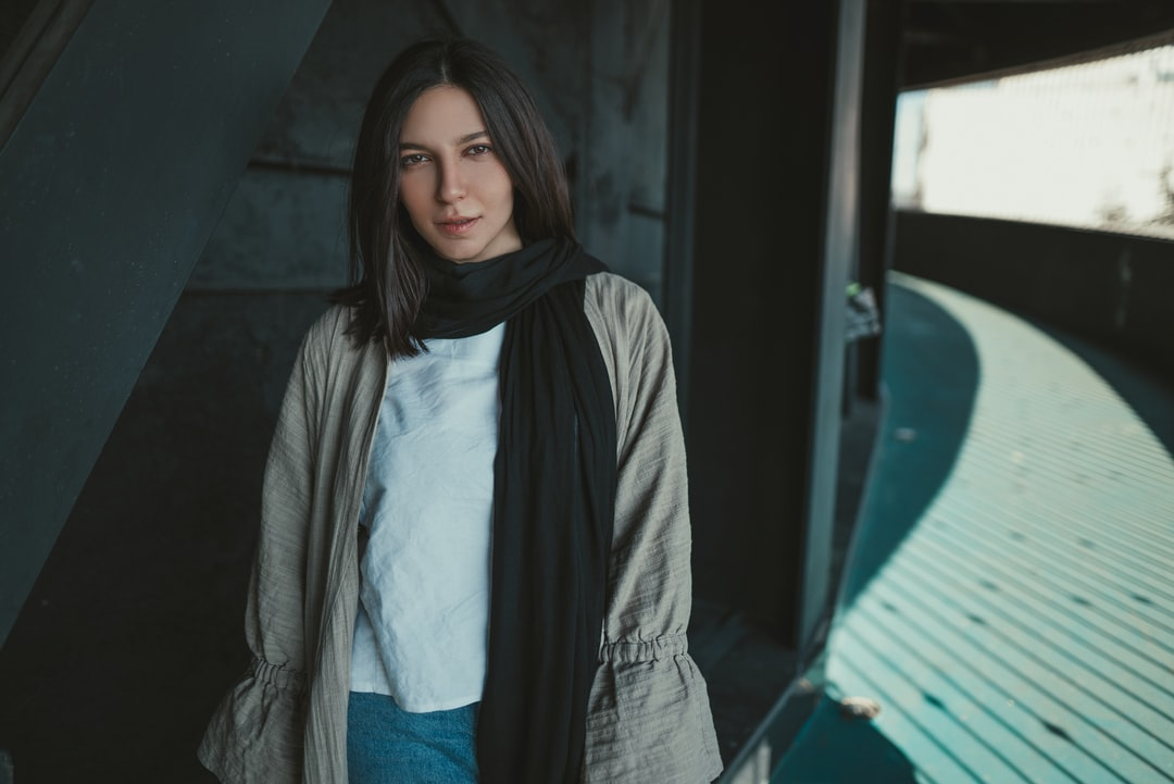 Woman In Gray Scarf and Blue Shirt - unsplash