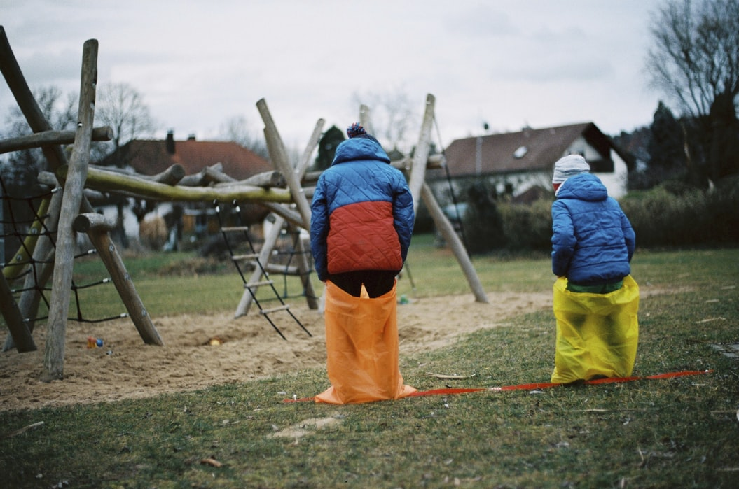 kids playing sack run on picnic party