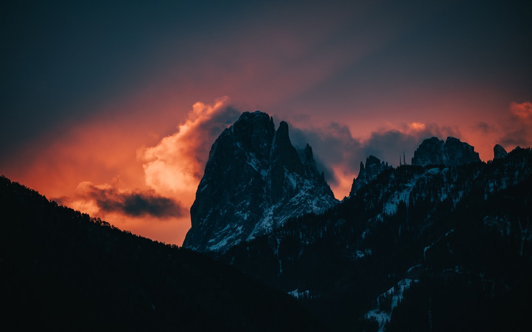 Rocky Mountain Under Cloudy Sky During Daytime - unsplash