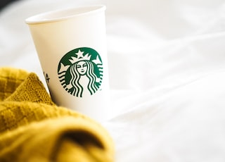 white and green starbucks cup