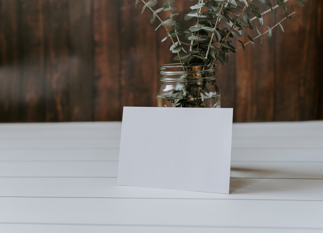 Blank Card With A Mason Jar of Eucalyptus - unsplash